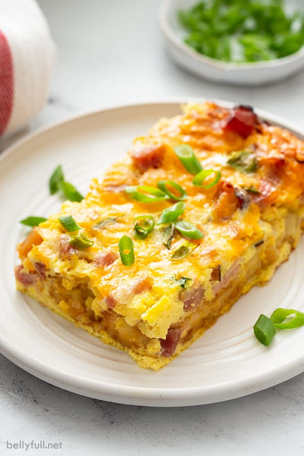 piece of hash brown egg casserole on white plate