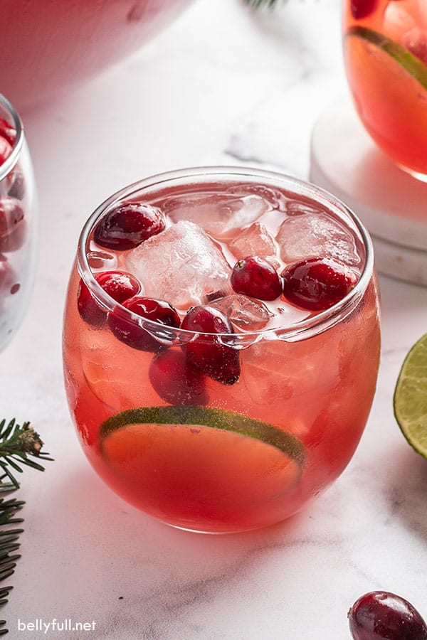 Christmas punch in glass with ice and cranberries