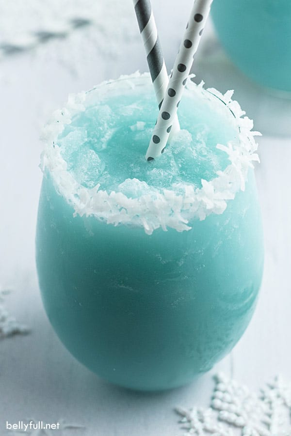 Jack Frost Blue Cocktail glass rimmed with coconut flakes