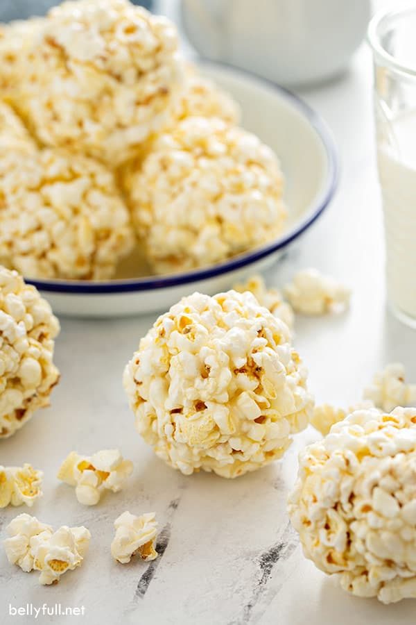 marshmallow popcorn ball with plate of balls in the background