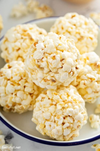 close up of popcorn balls on plate