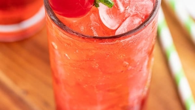 top down picture of a Shirley Temple drink garnished with a maraschino cherry