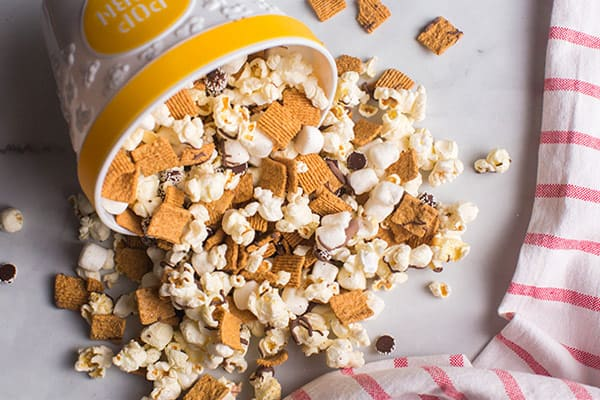 popcorn snack mix pouring out of bowl