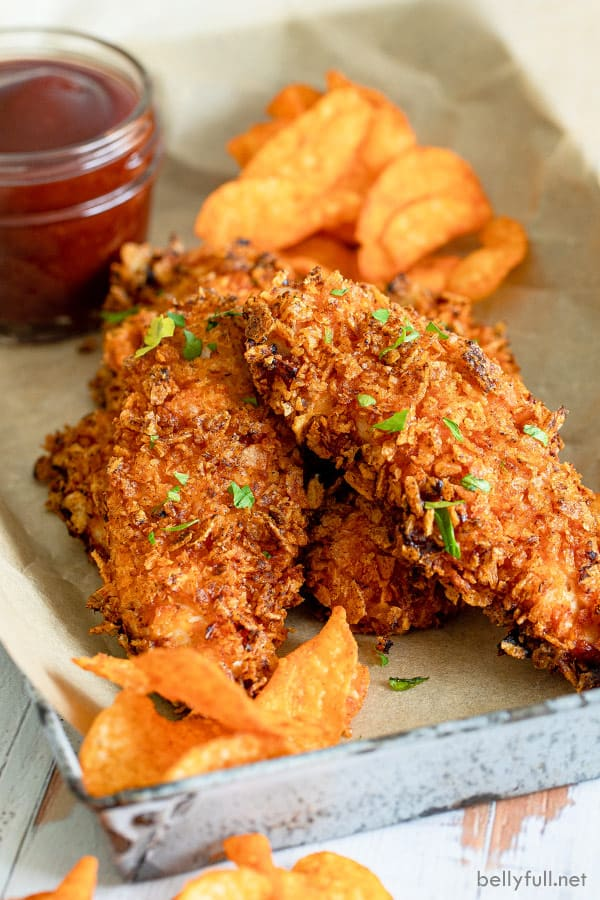 air fried chicken tenderloins on serving tray with chips