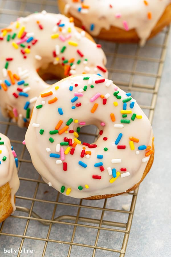 Close up glazed air fryer donuts with sprinkles