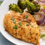 whole baked chicken breast on white plate