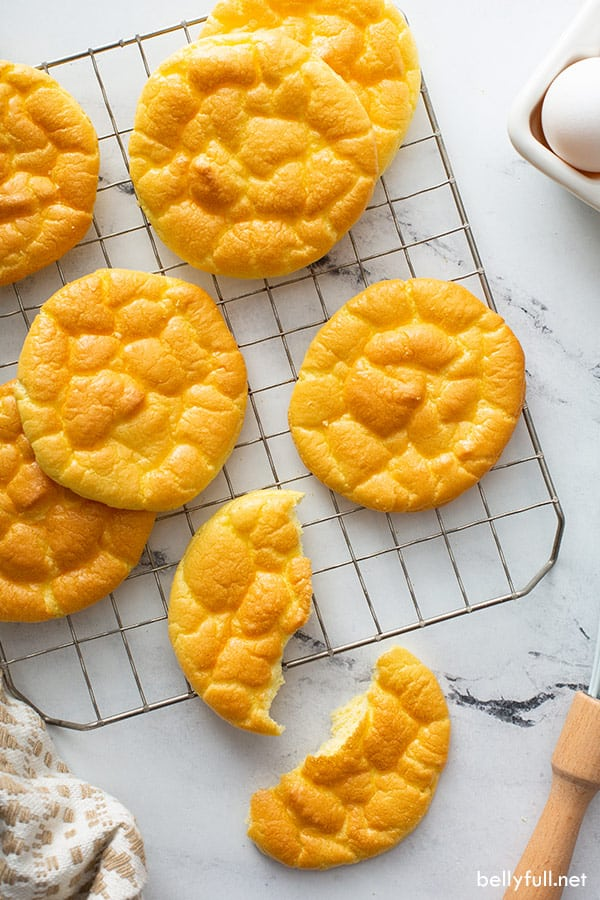 baked cloud bread slices on cooling rack
