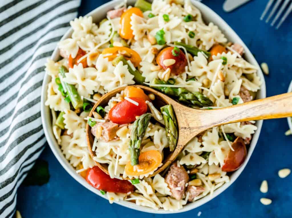 Italian pasta salad on wooden serving spoon