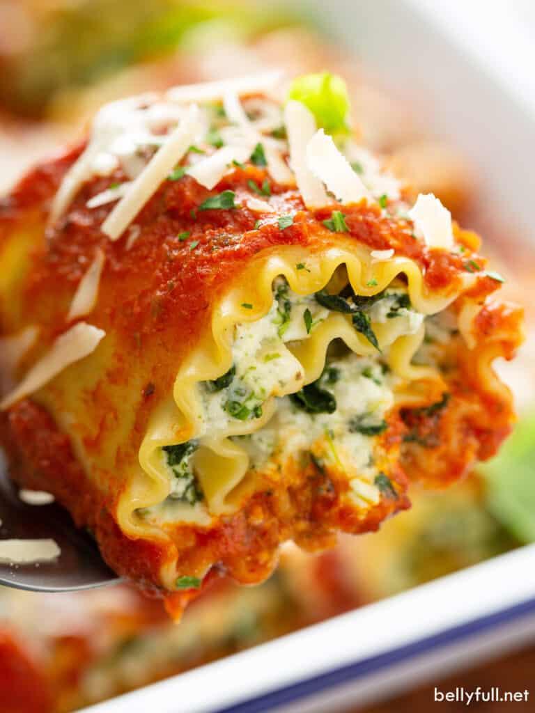 close up lasagna roll on serving spatula