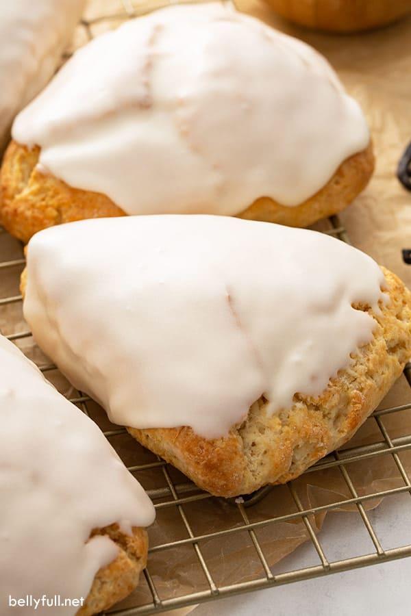 close up of baked scone with vanilla glaze