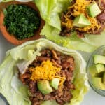 overhead of beef lettuce wrap with cheddar cheese and avocado