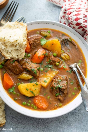 bowl of beef stew with crusty bread
