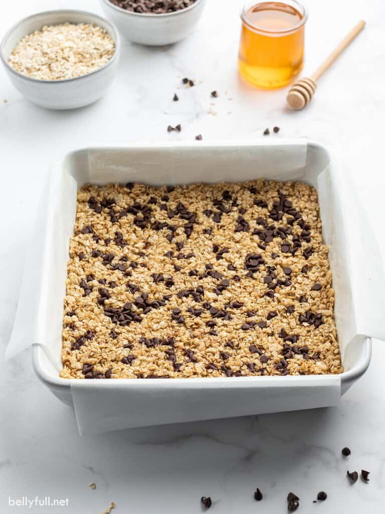 granola bars in pan before being cut