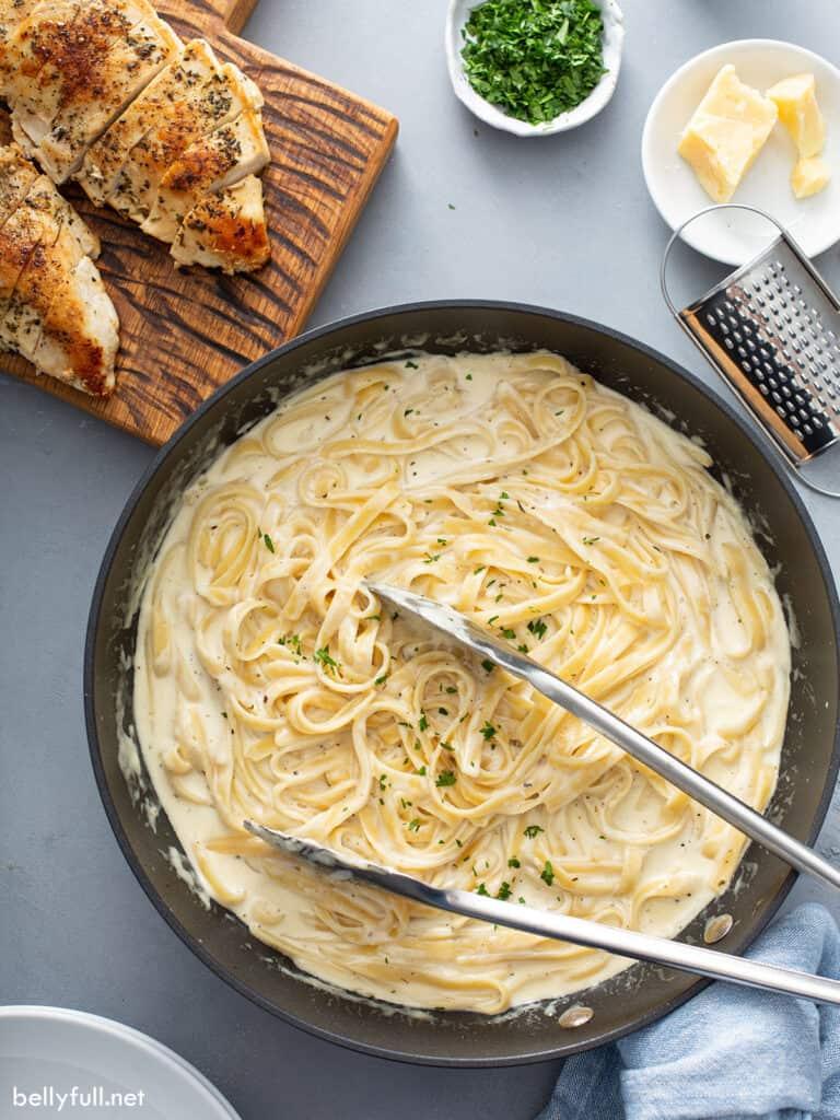 overhead of cooked Fettuccine pasta in cream sauce