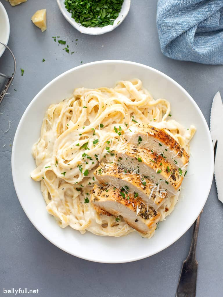 overhead of Chicken Alfredo serving on white plate