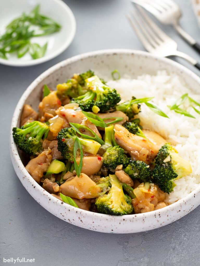 chicken broccoli stir fry with white rice in bowl