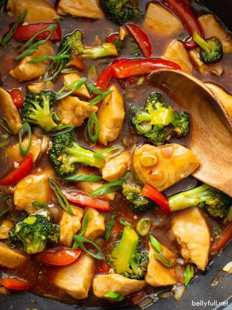 close up chicken stir fry in pan