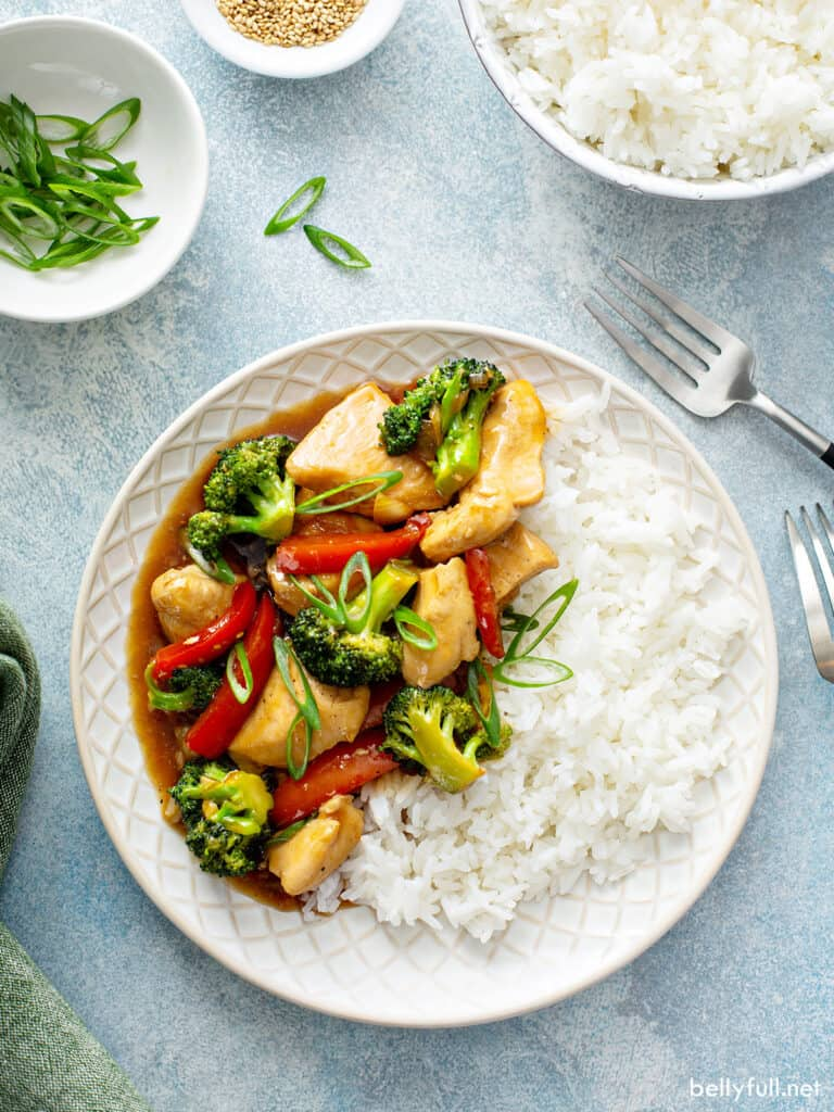 overhead chicken and veggie stir fry on plate with white rice
