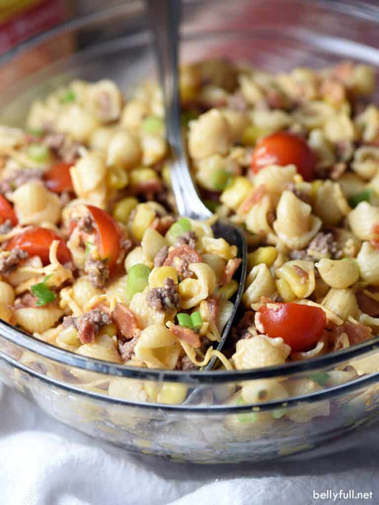 cowboy pasta salad in bowl with serving spoon