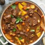 overhead Irish beef stew in white dutch oven pot
