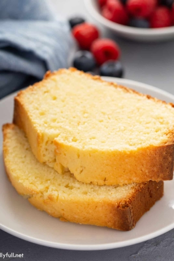 2 slices of stacked pound cake on white plate