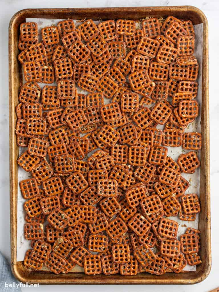 Single layer of seasoned pretzels on baking sheet