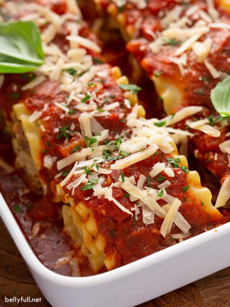 close up lasagna roll ups in casserole dish