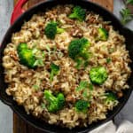 overhead sausage and rice with broccoli in skillet
