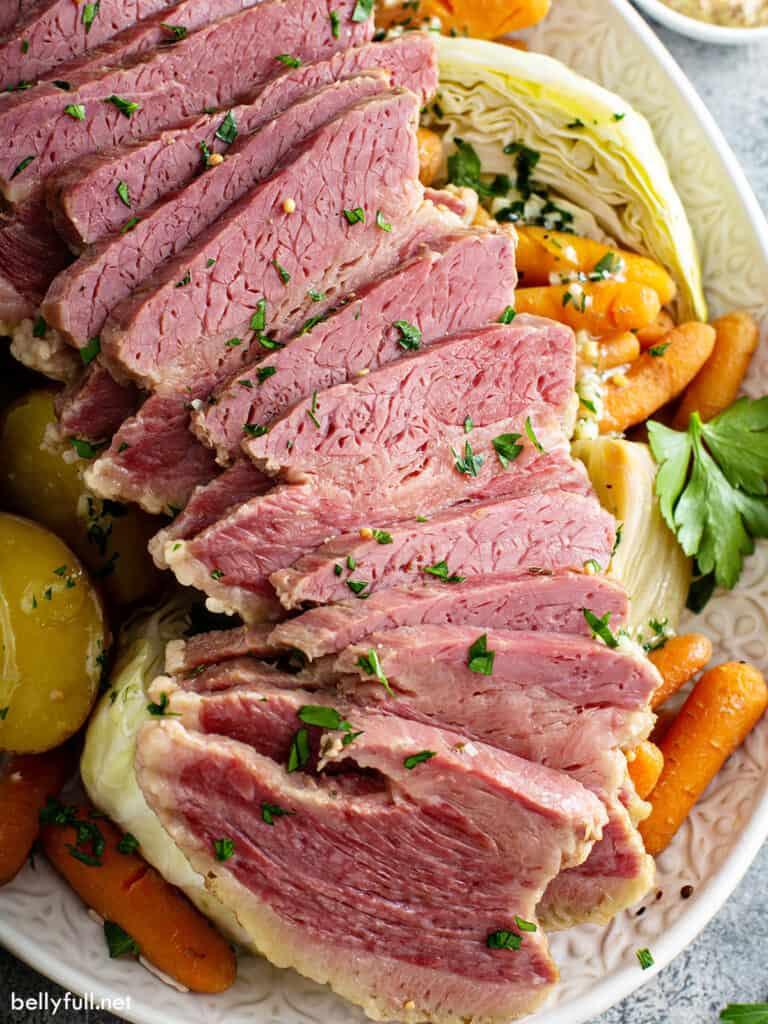 close up sliced corned beef on serving platter