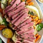 overhead sliced corned beef and vegetables on serving platter