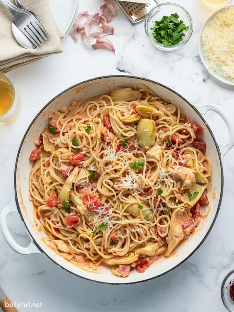 Artichoke pasta in white pan overhead picture