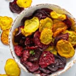 overhead baked red and golden beet chips in bowl