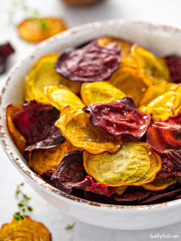 red and golden baked beet chips in bowl
