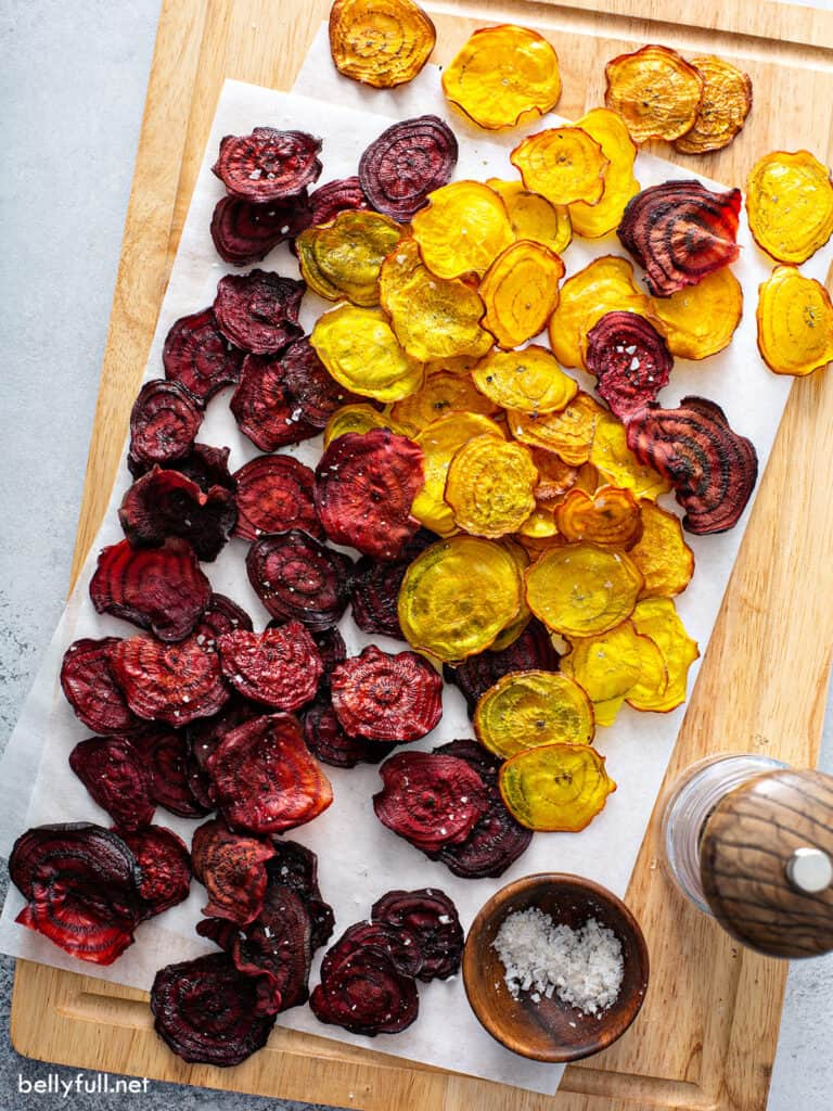 red and golden baked sliced beets on parchment paper