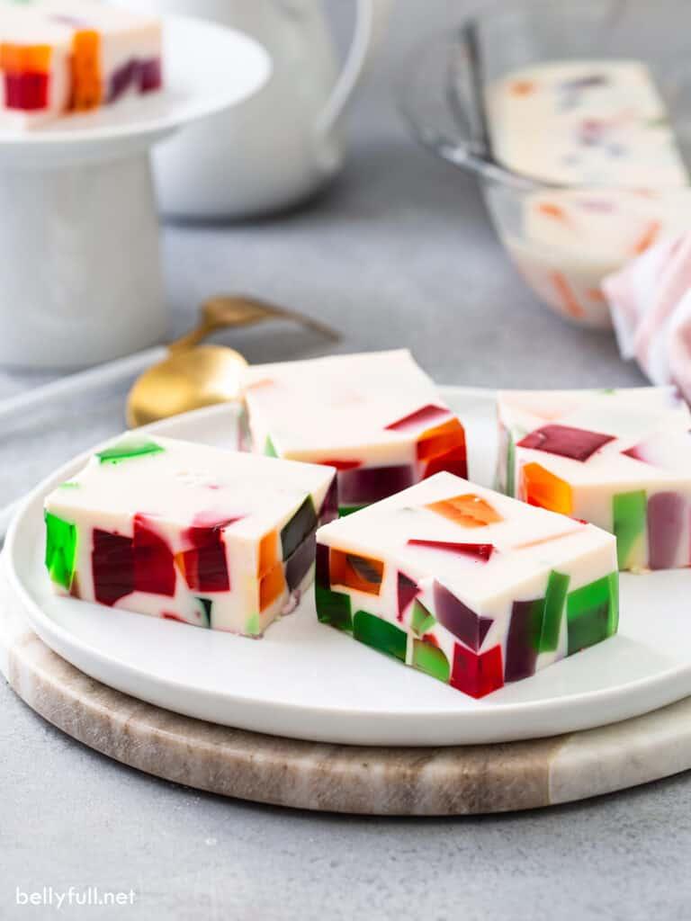 squares of broken glass jello on white serving tray
