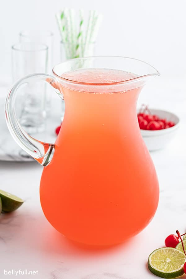 cherry limeade in glass pitcher