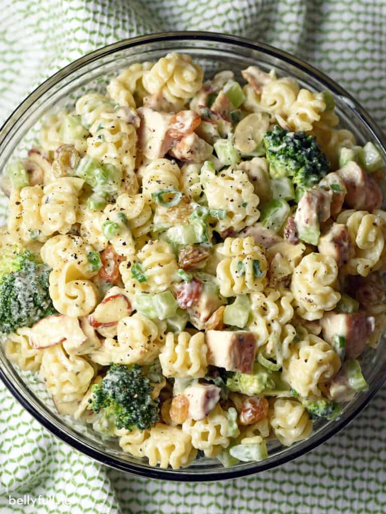 top down dressed chicken and broccoli pasta salad in serving bowl