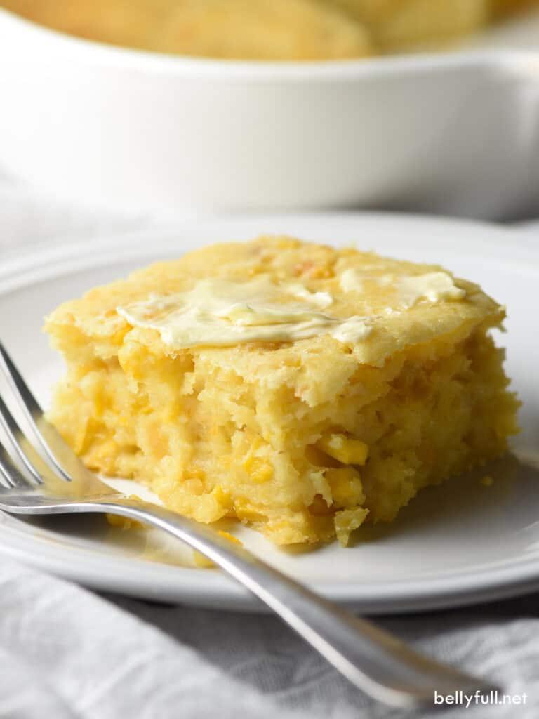 square piece of cornbread casserole on white plate