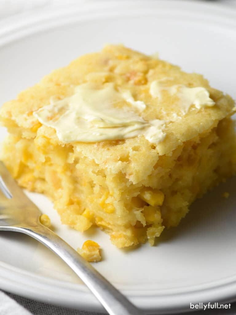 portion of cornbread pudding on white plate