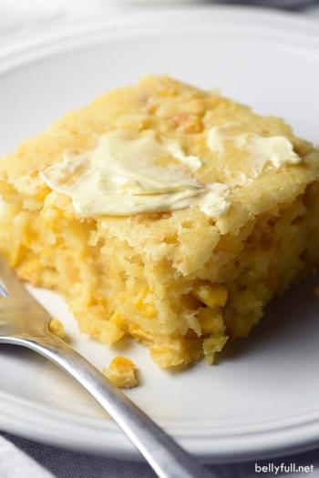 cornbread casserole portion on white plate