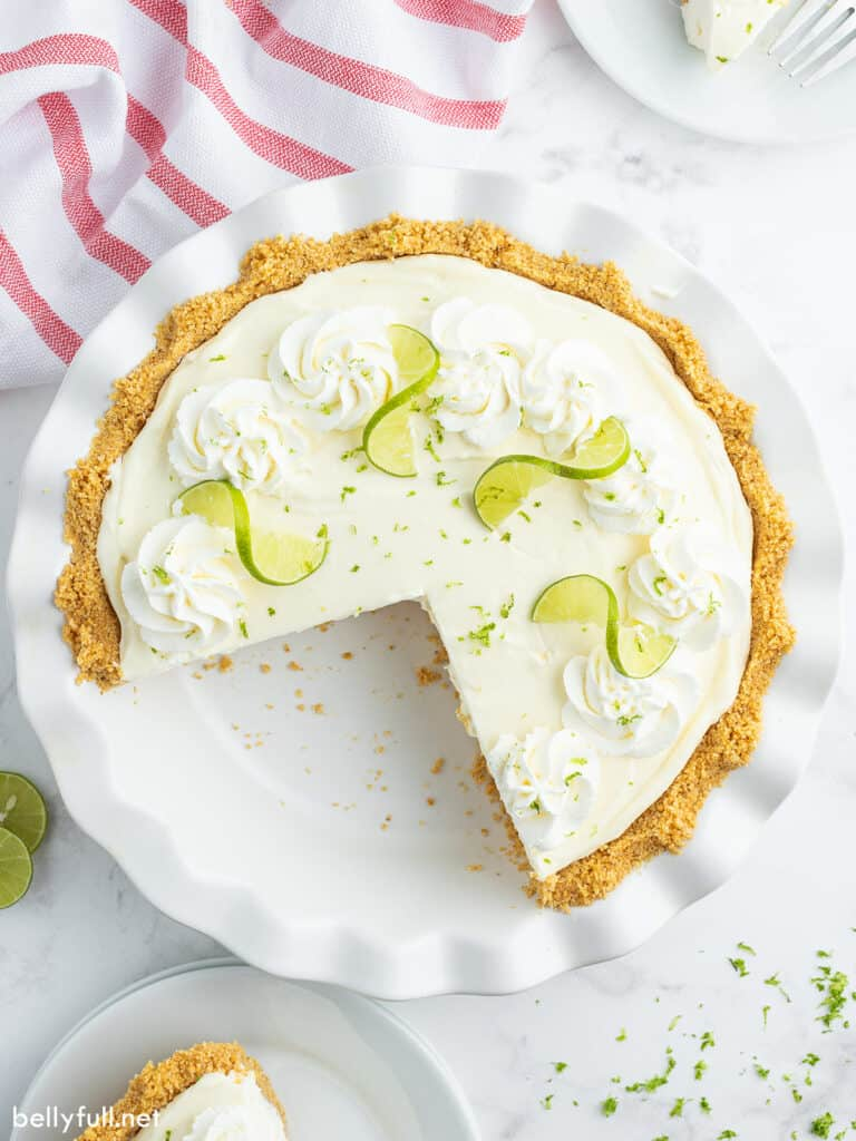 whole lime pie with 2 slices missing