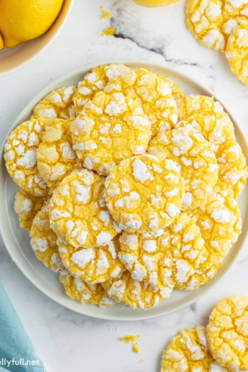 plate stacked with lemon crinkle cookies