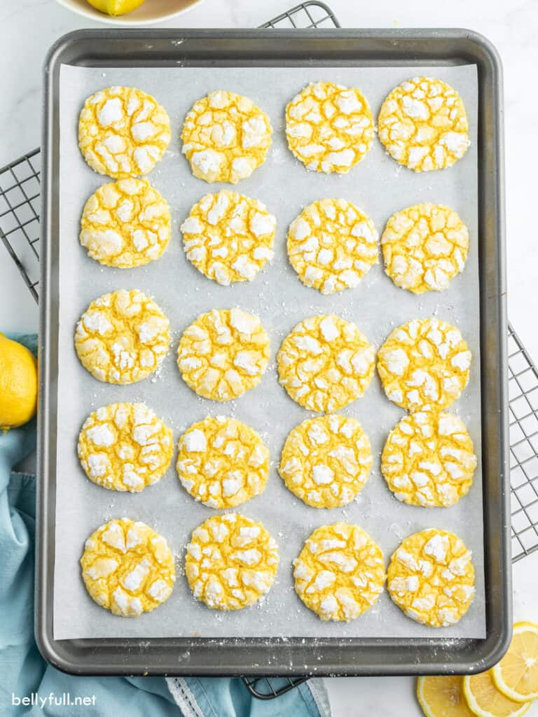 lemon cookies on baking sheet with parchment paper
