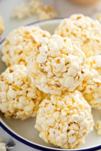 close up of popcorn balls on plate