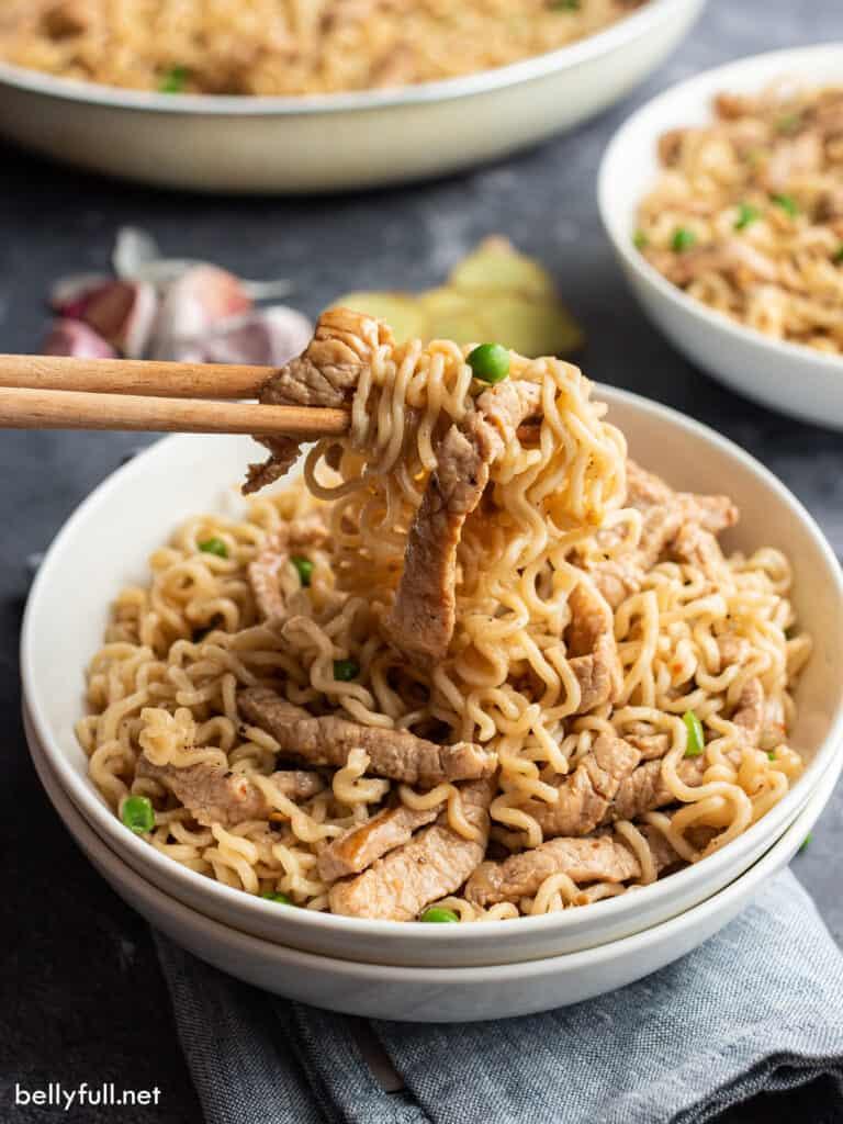 portion of pork ramen with chopsticks