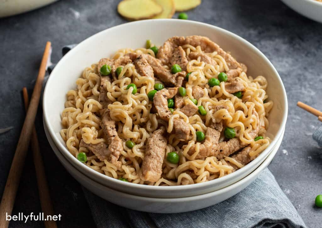 pork and ramen noodles in white bowl