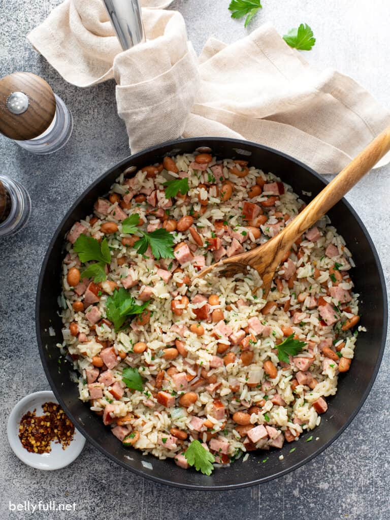 overhead cooked rice and beans in skillet