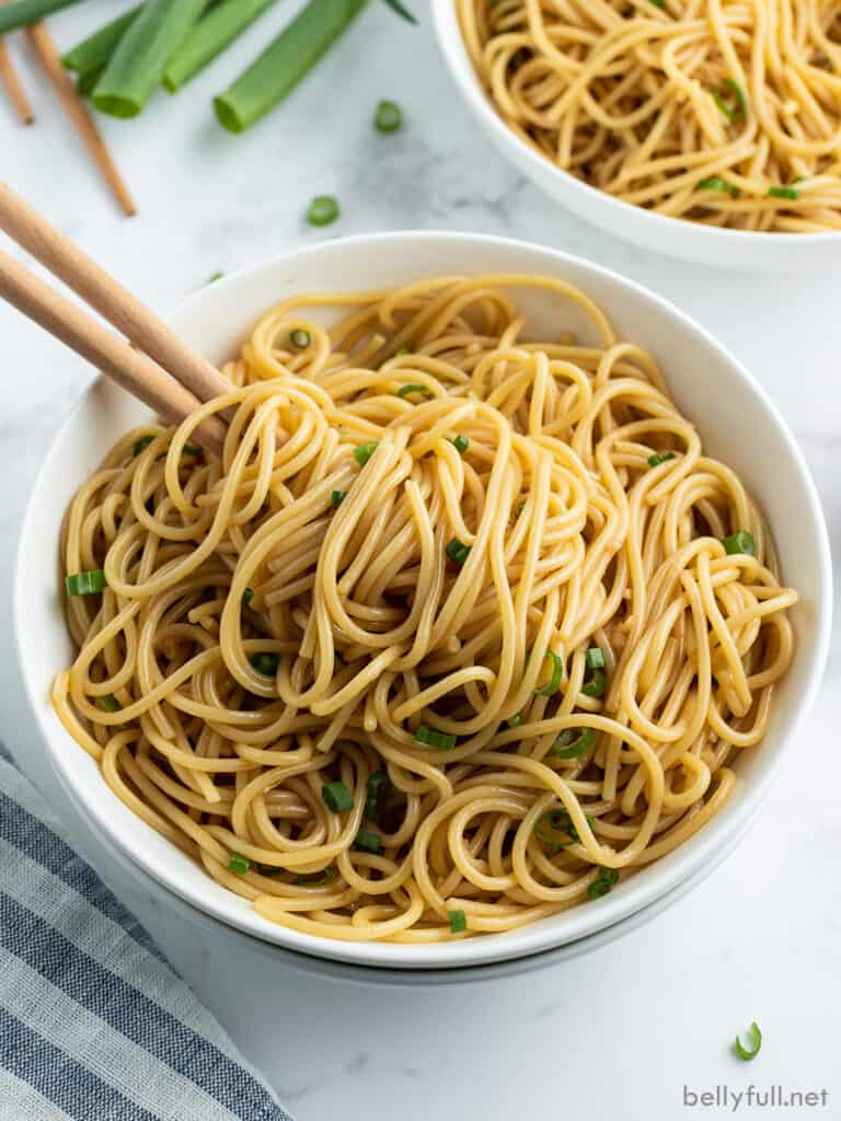 sesame noodles in bowl with chopsticks