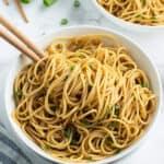 sesame noodles in bowl with chopsticks