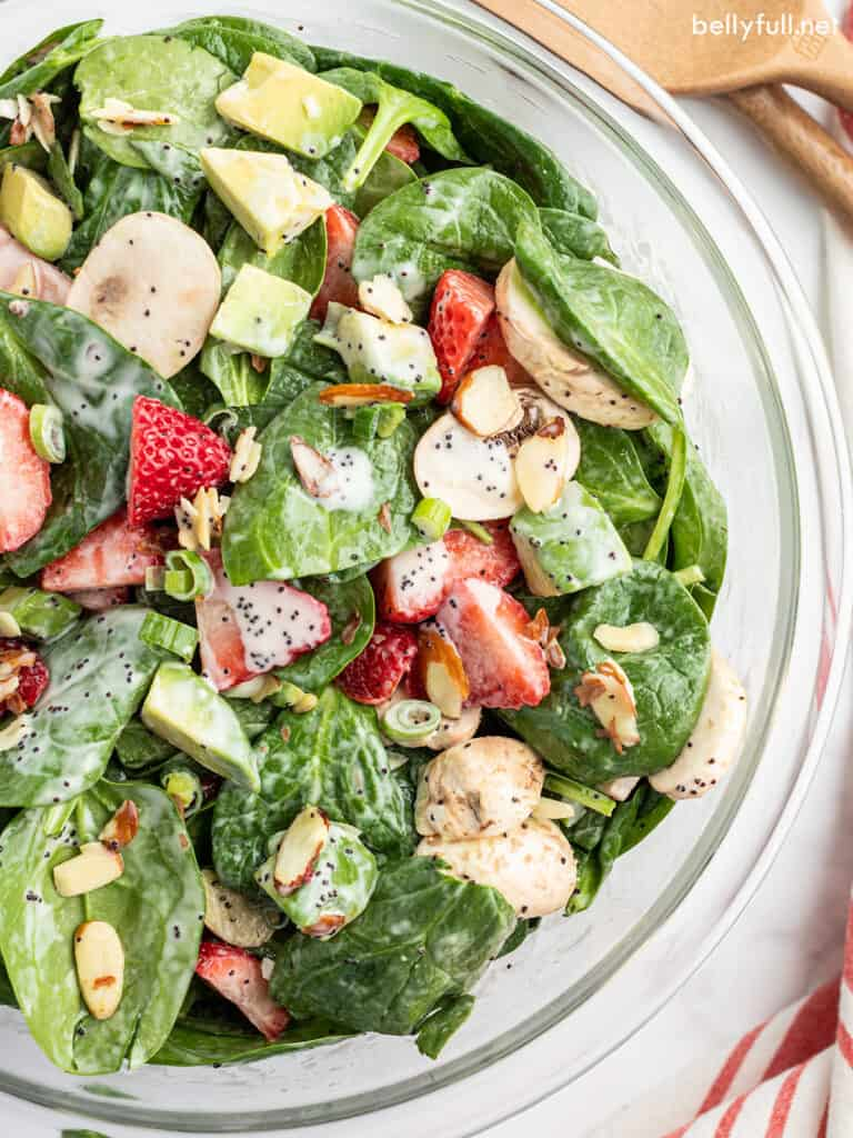Strawberry Spinach Salad coated with poppy seed dressing close up